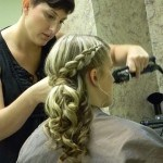 Shear Artistry hair stylist curling clients hair in New Holland, PA