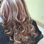 New Holland hair salon client with blonde and red curled hair